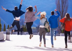 happy students jumping for joy